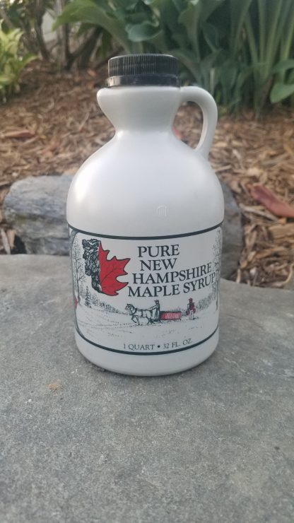 Quart of Maple Syrup photographed outside